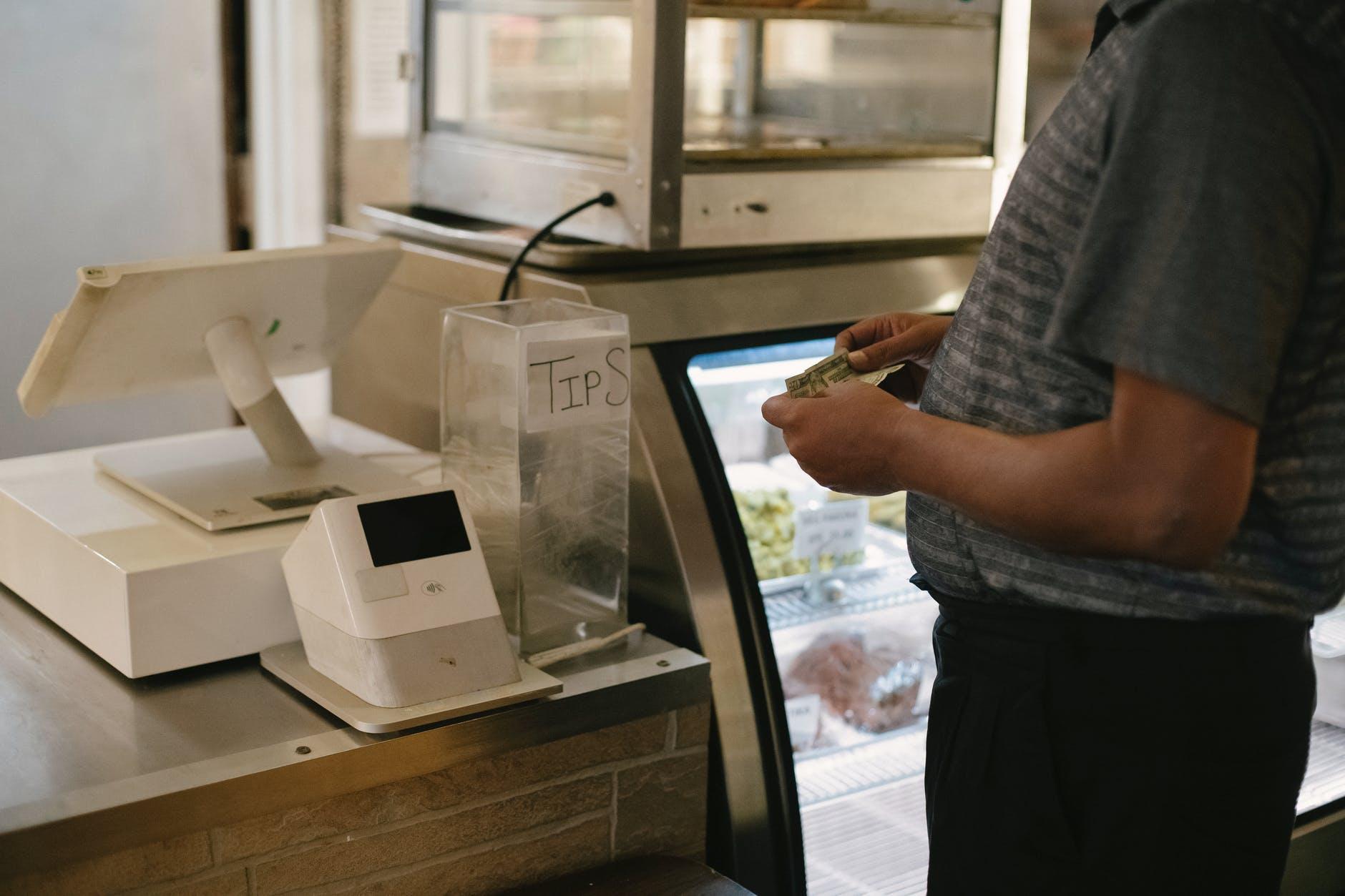 crop man standing near cash machine